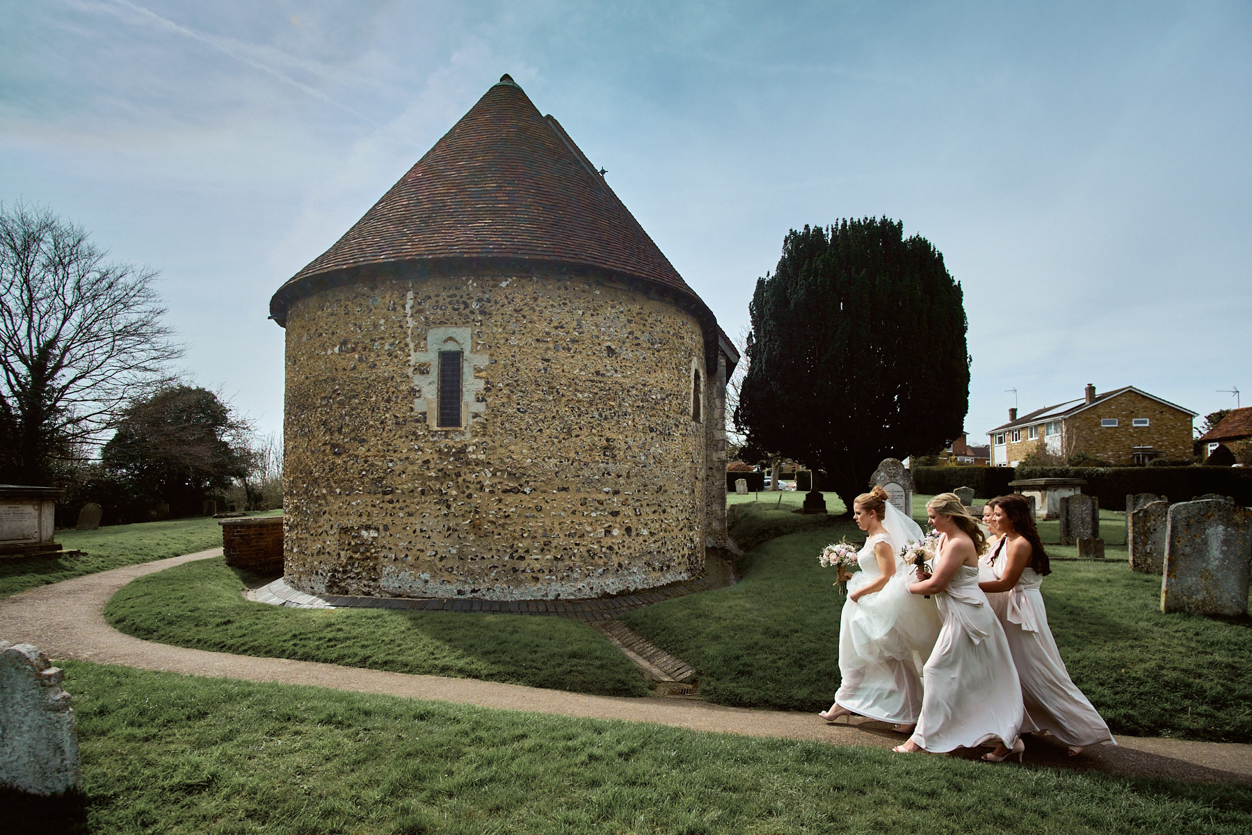Wedding photographer Hertfordshire – brides and bridesmaids rushing to Hertford church by Michael Stanton Photography.