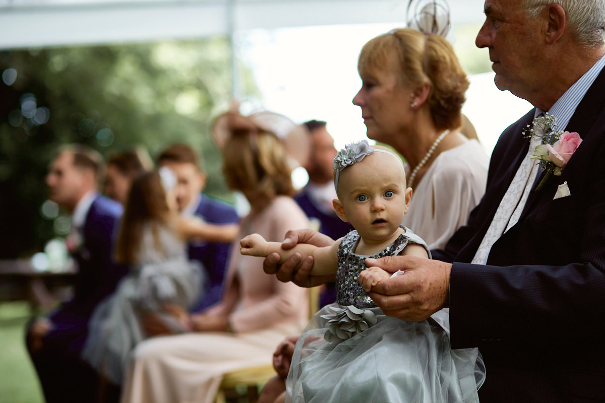 Funny wedding photo of a flower girl at Broyle Place