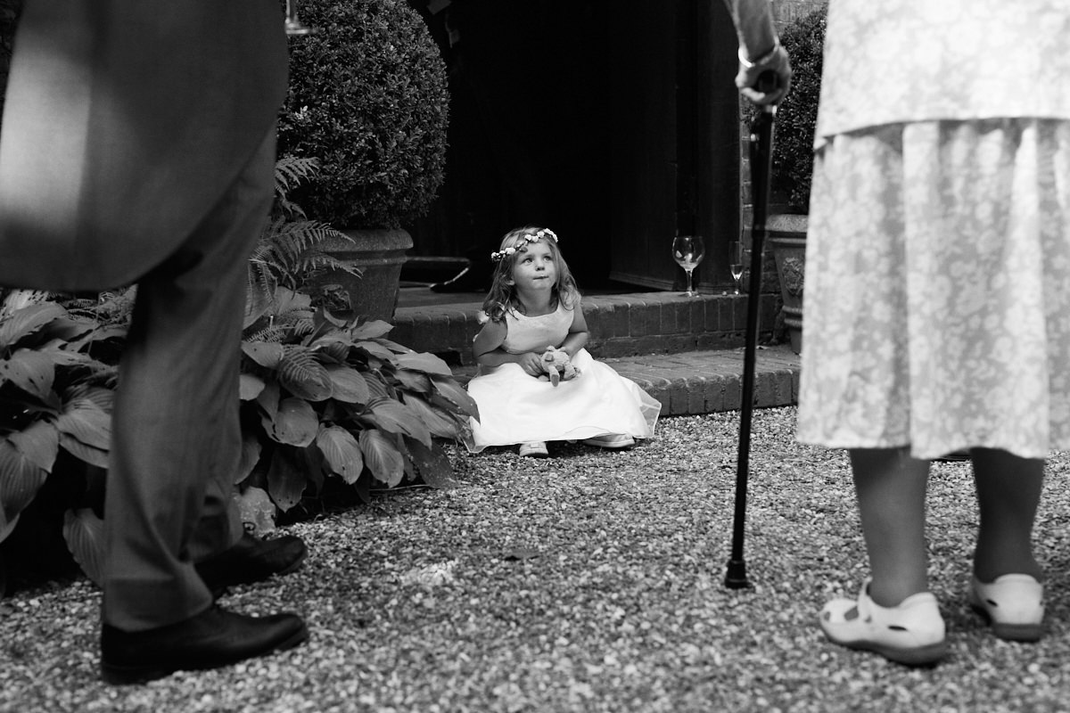 Funny wedding photo of a young girl confronted with an old lady