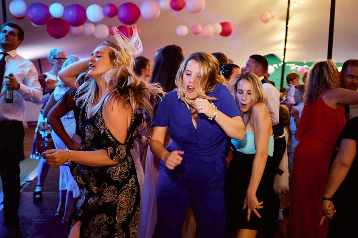 Funny wedding photo of 3 women dancing