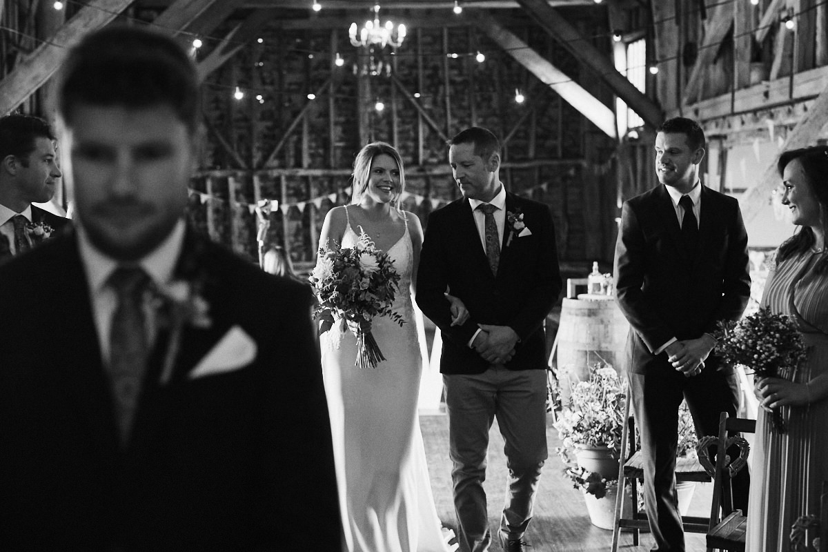 Groom waits for bride before wedding at Great Barn in Rolvenden Kent