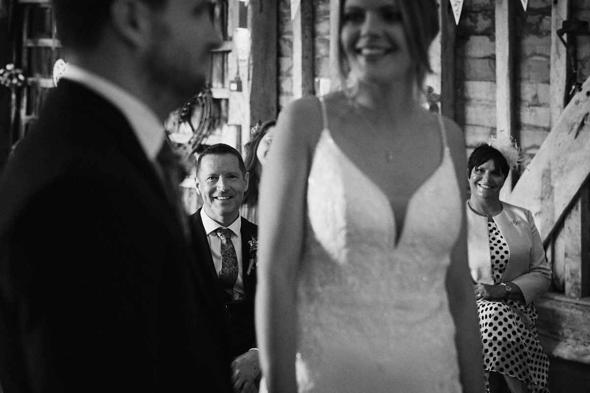 Smiles for bride and groom at Great Barn wedding in Kent