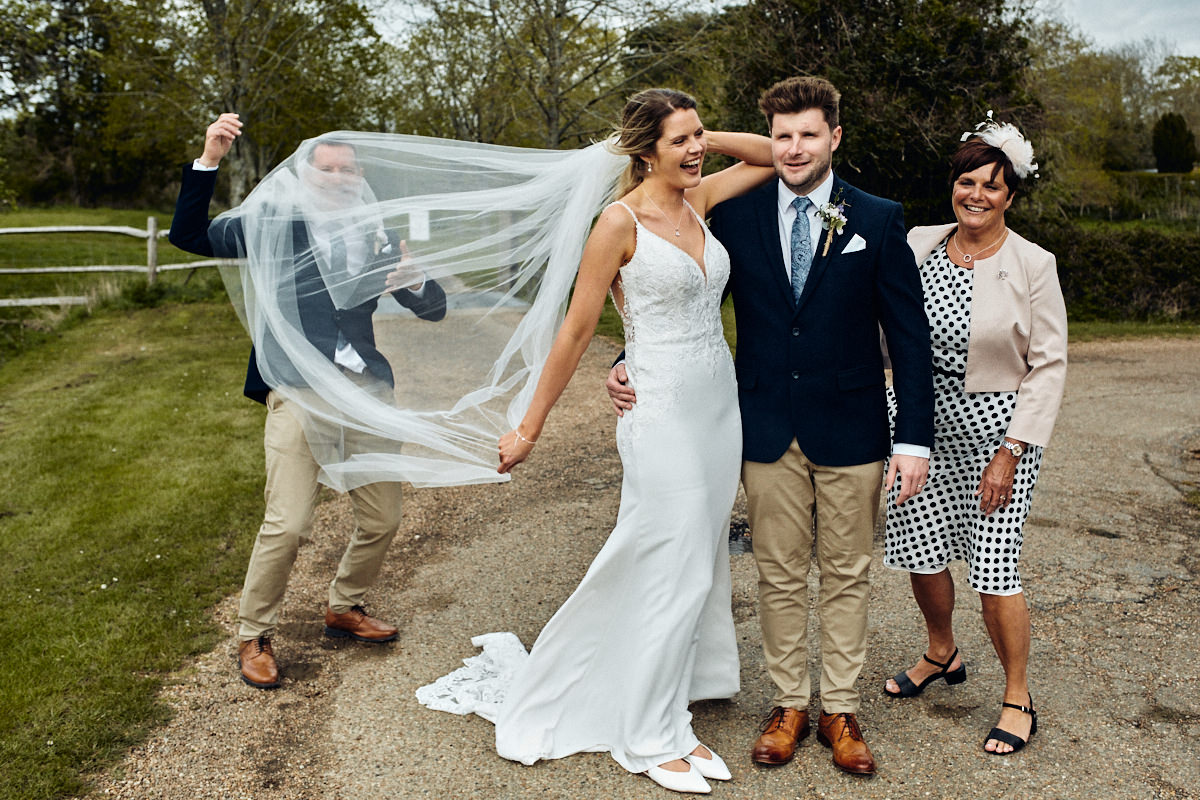 Funny photo of bride's veil covering dad's face