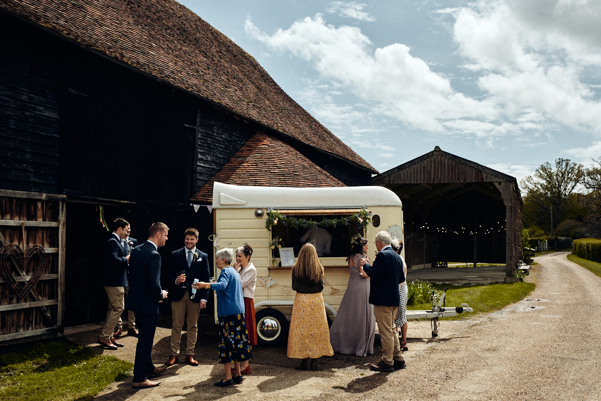 Guests gather at wedding at Great Barn in Rolvenden Kent