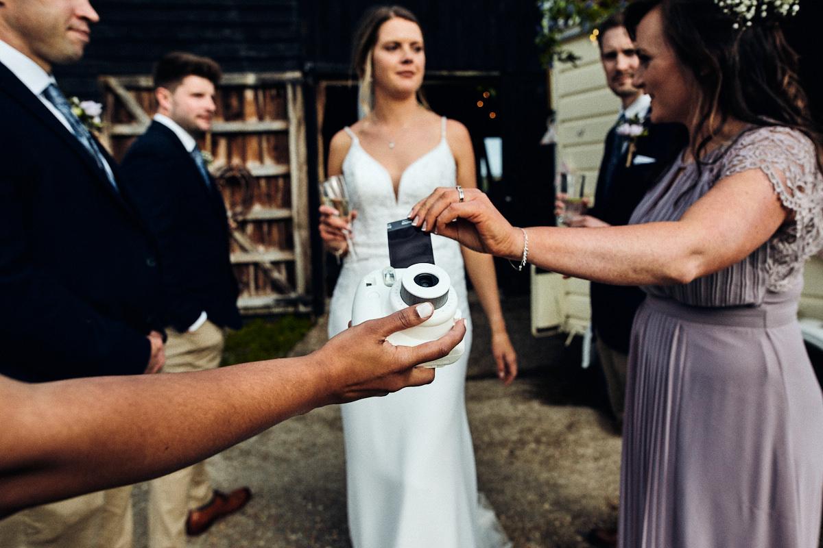 Instant camera at wedding at Great Barn in Rolvenden Kent