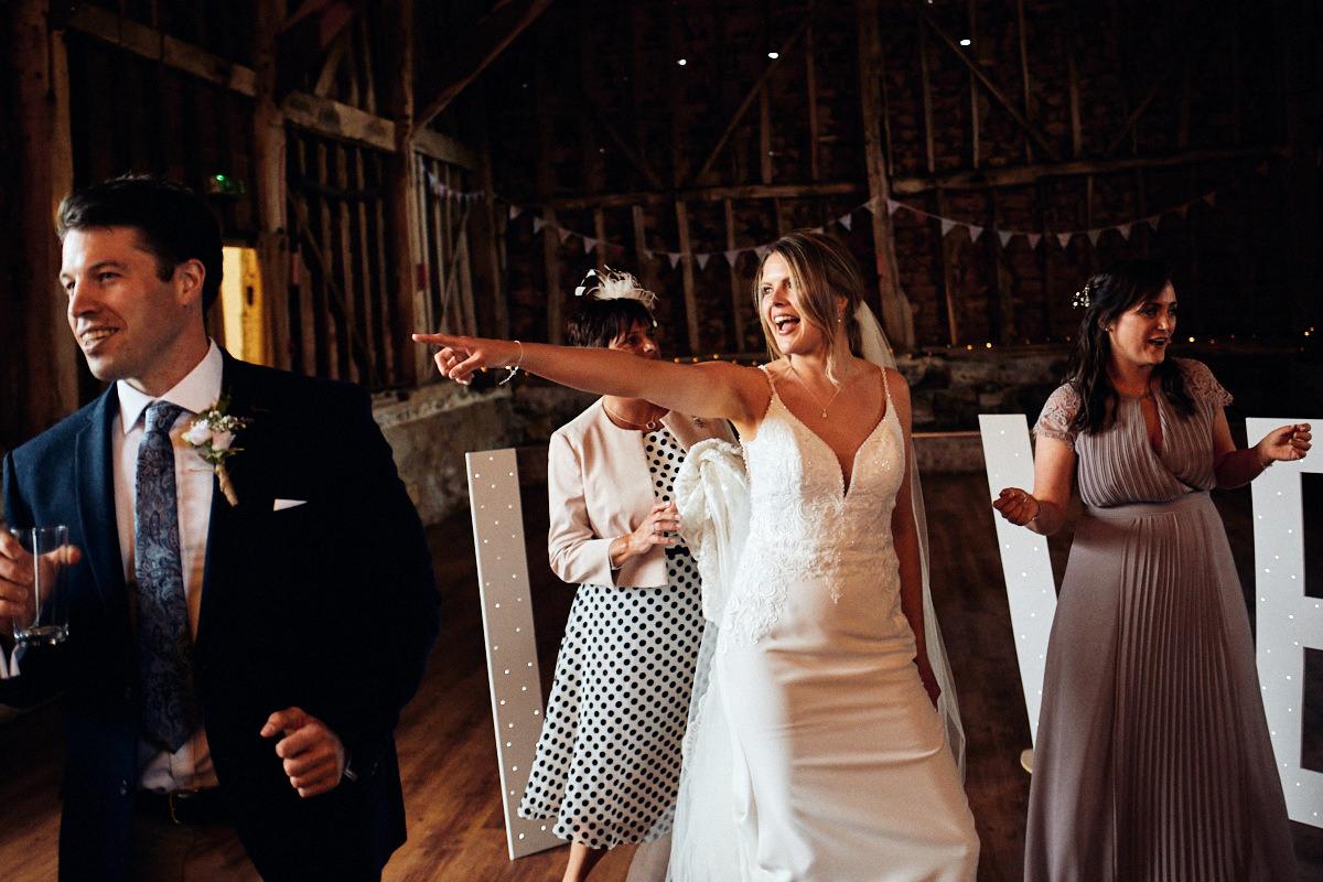 Bride dances in Great Barn in Kent