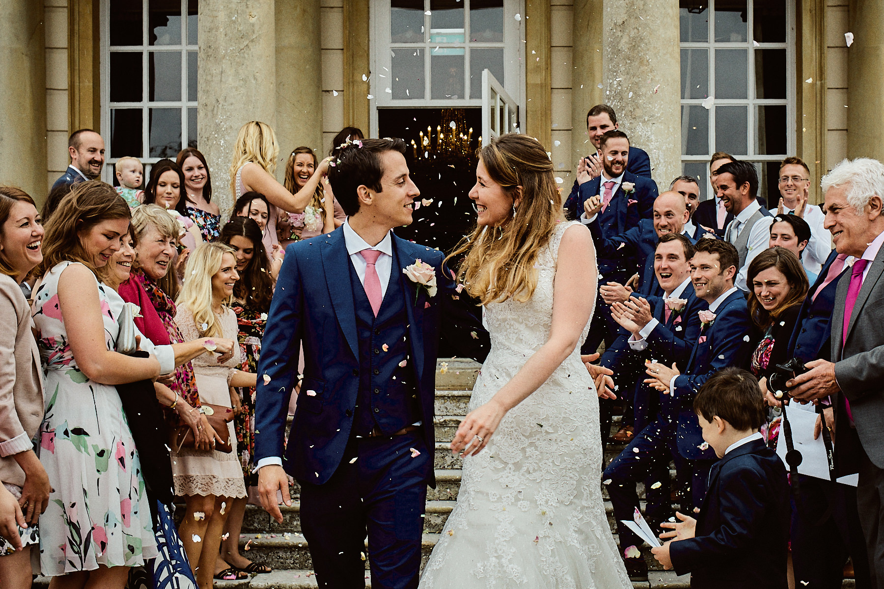 Bride and groom showered with confetti at their Buxted Park wedding in East Sussex